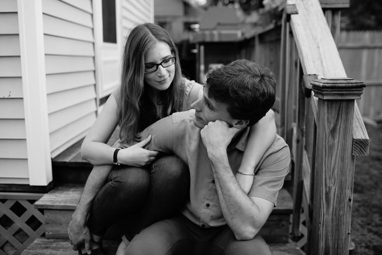 casual backyard engagement portrait