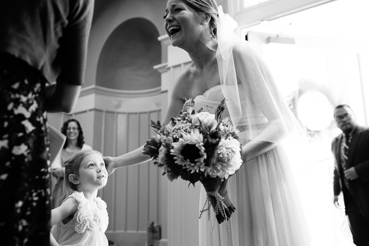 bride greets guests at St. Cecilias church Boston